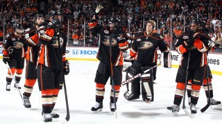 ANAHEIM, CA - MAY 16:  Teemu Selanne #8 of the Anaheim Ducks is surrounded by his teammates as he acknowledges the fans after the game against the Los Angeles Kings in Game Seven of the Second Round of the 2014 Stanley Cup Playoffs at Honda Center on May 16, 2014 in Anaheim, California. (Photo by Debora Robinson/NHLI via Getty Images)