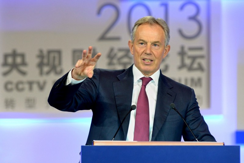 Former British Prime Minister Tony Blair delivers a speech at the 2013 CCTV Financial Forum in Beijing, China, 12 December 2013.
