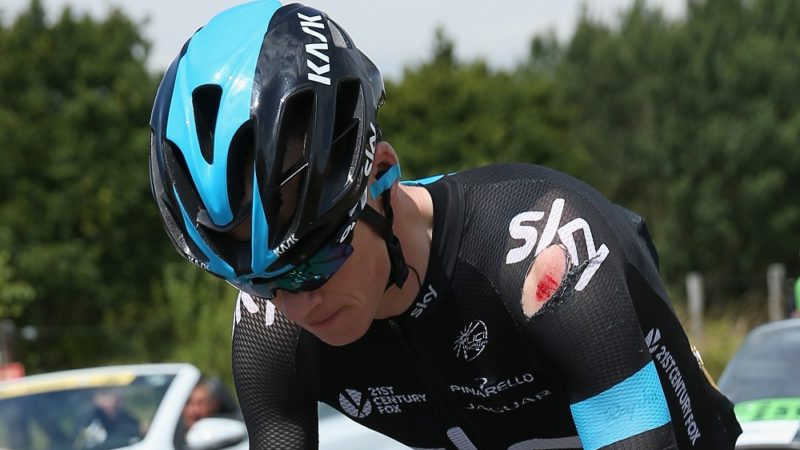 LE TOUQUET-PARIS-PLAGE, FRANCE - JULY 08:  Chris Froome of Great Britain and Team Sky chases back to the peloton after being involved in a crash just afte the start of stage four of the 2014 Le Tour de France from Le Touquet-Paris-Plage to Lille on July 8, 2014 in Le Touquet-Paris-Plage, France.  (Photo by Doug Pensinger/Getty Images)