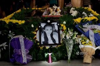 Qiu Yuanyuan  (temetés, )