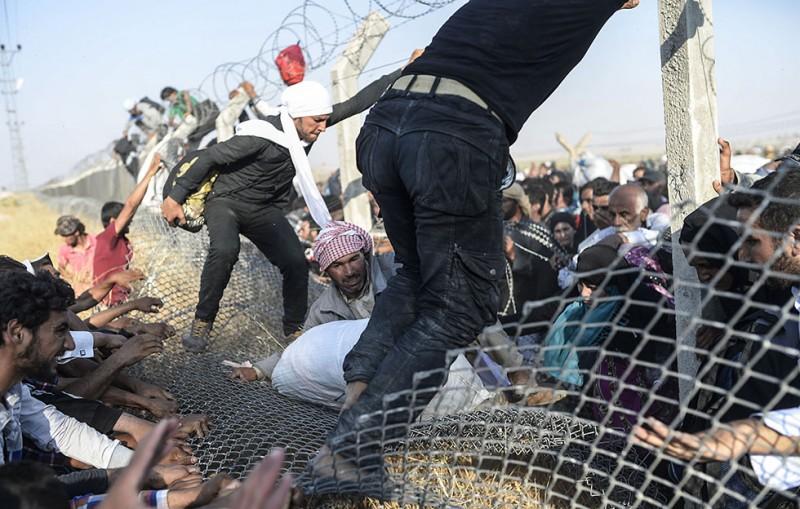 szíriai menekültek (Array)
