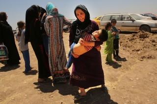 Menekültek hagyják el az iszlám kalifátust (Array)
