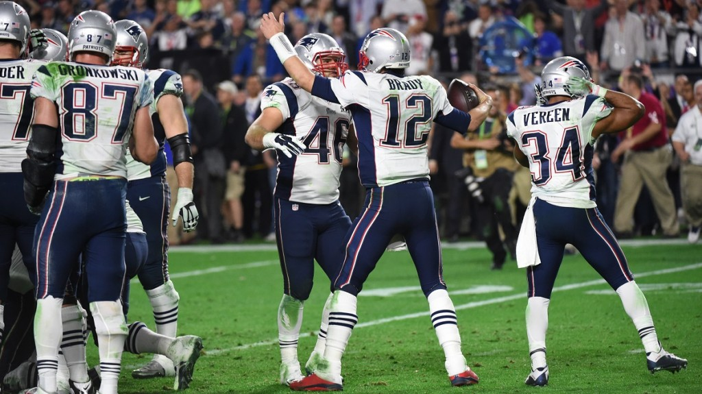 Tom Brady(12) and james Develin(46) celebrate after defeating the Seattle Seahawks in Super Bowl XLIX  February 1, 2015 at the at University of Phoenix Stadium in Glendale, Arizona.        AFP PHOTO /  TIMOTHY  A. CLARY
