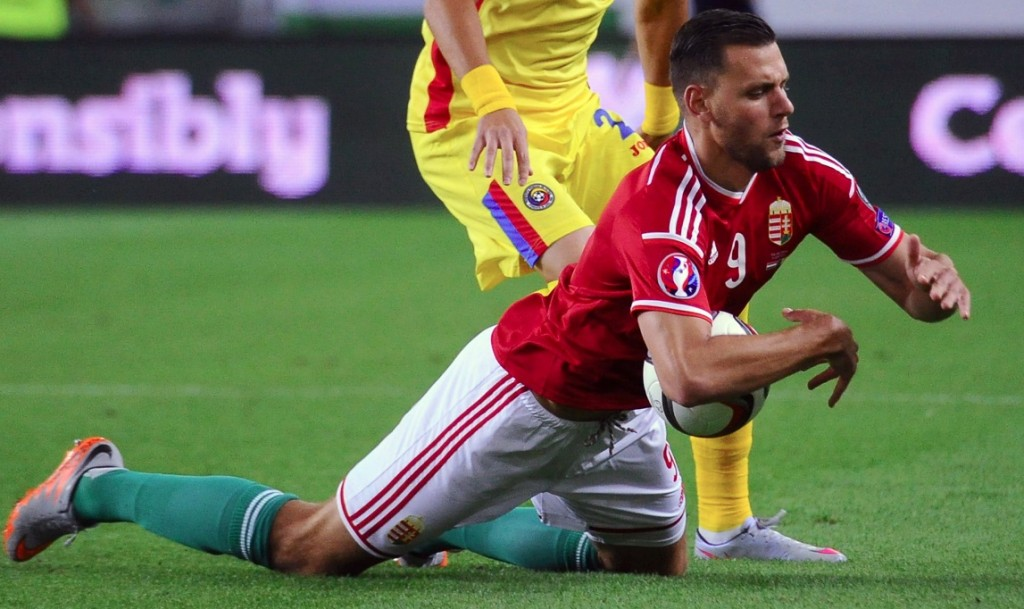 Romanian Dragos Grigore (R) vies with Hungarian forward Adam Szalai (L) during the Euro 2016 qualifying football match between Hungary and Romania in Budapest, on September 4, 2015.  AFP PHOTO / ATTILA KISBENEDEK