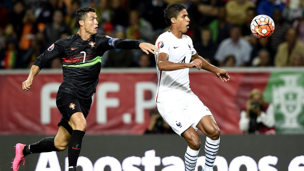 Portugal's forward Cristiano Ronaldo (L) vies with France's defender Raphael Varane during the Euro 2016 friendly football match Portugal vs France at the Jose Alvalade stadium in Lisbon on September 4, 2015.  France won 0-1. AFP PHOTO/ FRANCK FIFE