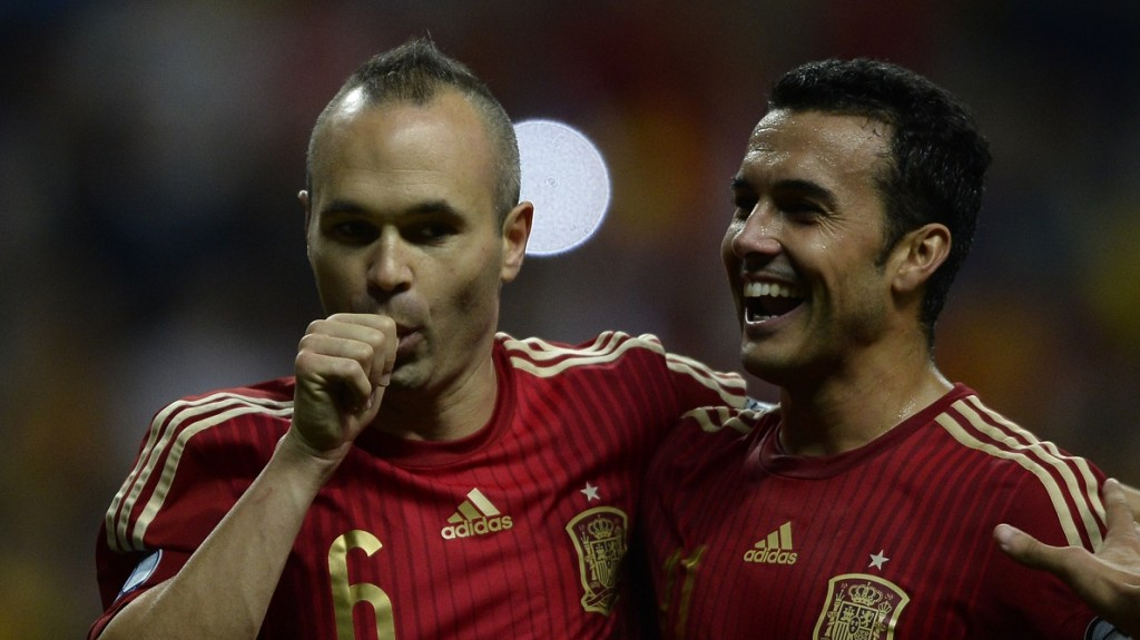 Spain's midfielder Andres Iniesta (L) celebrates with Spain's forward Pedro Rodriguez after scoring a goal during the Euro 2016 qualifying football match Spain vs Slovakia at the Carlos Tartiere stadium in Oviedo on September 5, 2015.  AFP PHOTO/ MIGUEL RIOPA