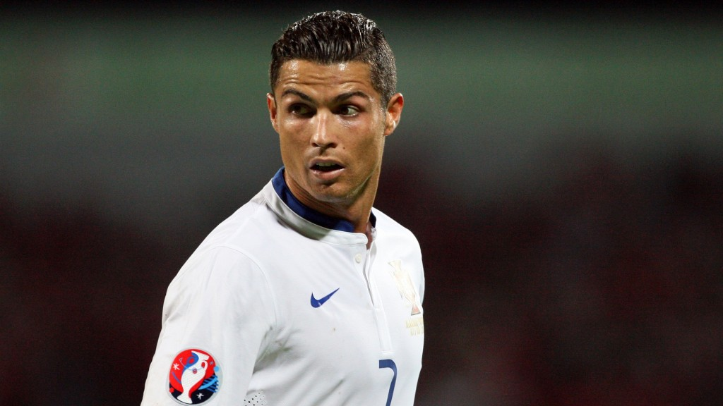 Portugal's Cristiano Ronaldo reacts during the Euro 2016 qualifying football match between Albania and Portugal at the Elbasan Arena in Elbasan on September 7, 2015. Portugal defeated Albania 1-0. AFP PHOTO / GENT SHKULLAKU