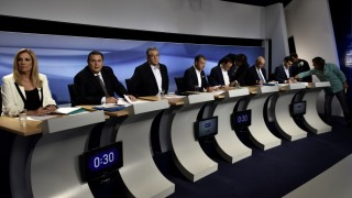(L-R) Greece's Socialist PASOK party leader Fofi Gennimata, right-wing Independent Greeks leader Panos Kamenos, Communist Party secretary general Dimitris Koutsoumbas, Potami party leader Stavros Theodorakis, leftist Popular Unity leader Panagiotis Lafazanis, conservative New Democracy party leader Vangelis Meimarakis and SYRIZA party leader and former prime minister Alexis Tsipras prepare for a pre-election debate in Athens on September 9, 2015. Greeks go to the polls for their fifth time in six years on September 20, as former premier Alexis Tsipras seeks a fresh mandate to push through commitments made under the new 86-billion-euro ($96-billion) bailout. AFP PHOTO / ARIS MESSINIS