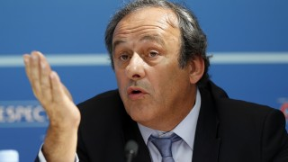 UEFA chief Michel Platini gestures as he speaks during a UEFA press conference after the draw for the UEFA Europa League football group stage 2015/16 on August 28, 2015 in Monaco.  AFP PHOTO / VALERY HACHE