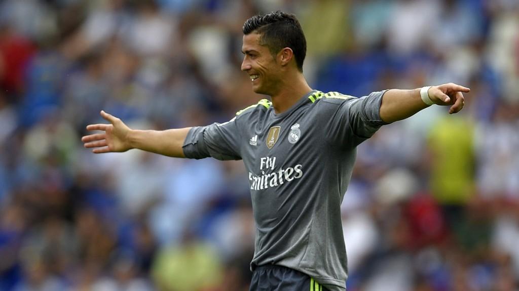 Real Madrid's Portuguese forward Cristiano Ronaldo celebrates after scoring during the Spanish league football match RCD Espanyol vs Real Madrid CF at the Power8 stadium in Cornella de Llobregat on September 12, 2015. AFP PHOTO/ LLUIS GENE