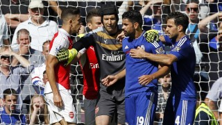 Arsenal's Brazilian defender Gabriel (L) and Chelsea's Brazilian-born Spanish striker Diego Costa (2nd R) are separated by Arsenal's Czech goalkeeper Petr Cech (C) as they clash during the English Premier League football match between Chelsea and Arsenal at Stamford Bridge in London on September 19, 2015. AFP PHOTO / IAN KINGTON   RESTRICTED TO EDITORIAL USE. No use with unauthorized audio, video, data, fixture lists, club/league logos or 'live' services. Online in-match use limited to 75 images, no video emulation. No use in betting, games or single club/league/player publications.