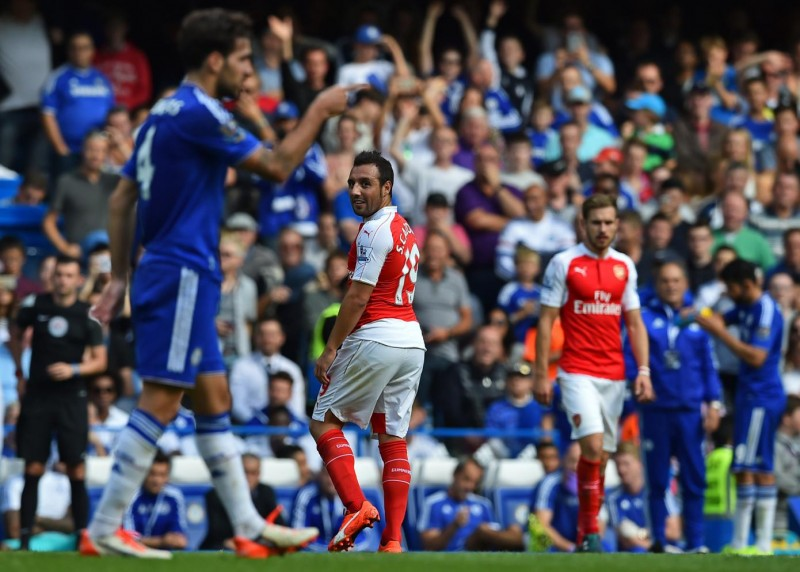 Arsenal's Spanish midfielder Santi Cazorla (2nd L) reacts after being sent off during the English Premier League football match between Chelsea and Arsenal at Stamford Bridge in London on September 19, 2015. AFP PHOTO / BEN STANSALL  RESTRICTED TO EDITORIAL USE. No use with unauthorized audio, video, data, fixture lists, club/league logos or 'live' services. Online in-match use limited to 75 images, no video emulation. No use in betting, games or single club/league/player publications.
