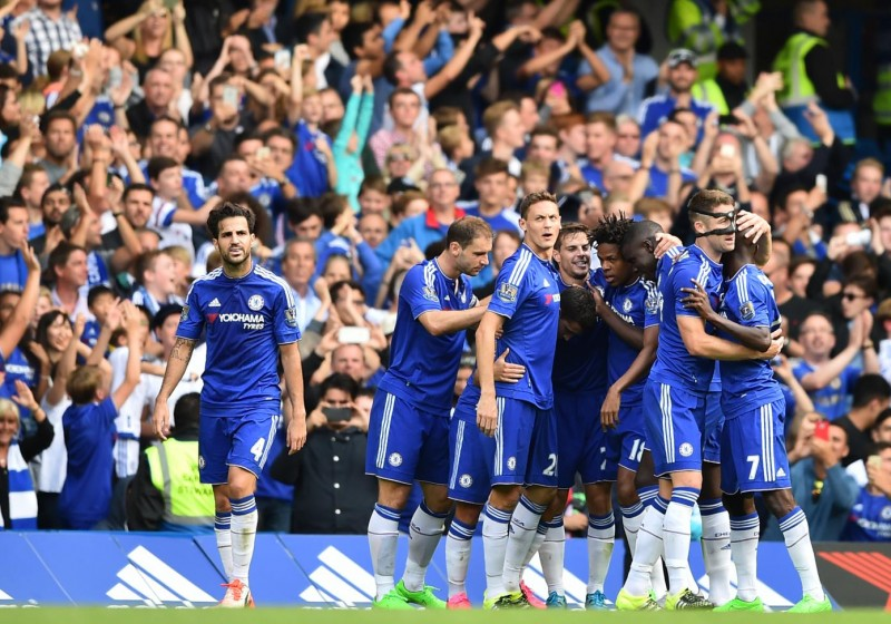 Chelsea players celebrate after scoring their second goal during the English Premier League football match between Chelsea and Arsenal at Stamford Bridge in London on September 19, 2015. Chelsea won the game 2-0. AFP PHOTO / BEN STANSALL  RESTRICTED TO EDITORIAL USE. No use with unauthorized audio, video, data, fixture lists, club/league logos or 'live' services. Online in-match use limited to 75 images, no video emulation. No use in betting, games or single club/league/player publications.