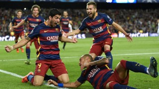 Barcelona's Uruguayan forward Luis Suarez celebrates a goal with his teammates during the UEFA Champions League football match FC Barcelona vs Bayer Leverkusen at the Camp Nou stadium in Barcelona on September 29, 2015. AFP PHOTO / LLUIS GENE