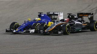 ERICSSON marcus (swe) sauber f1 c34, HULKENBERG nico (ger) force india vjm08 action during 2015 Formula 1 FIA world championship, Bahrain Grand Prix, at Sakhir from April 16 to 19th. Photo Florent Gooden / DPPI