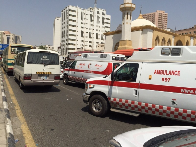 MECCA, SAUDI ARABIA - SEPTEMBER 24: Ambulances are seen on a road after at least 310 Hajj pilgrims were killed – and another 450 injured – in a stampede that took place near the city of Mecca in Saudi Arabia on September 24, 2015. The stampede occurred in the town of Mina, located roughly five kilometers east of Mecca, as pilgrims performed a ritual in which they threw stones at a structure representing the devil. Ozkan Bilgin / Anadolu Agency