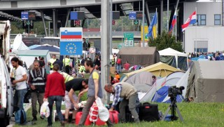 BREGANA, CROATIA - SEPTEMBER 20: Refugees are seen beside tents as they wait at the Croatia's border town Bregana to cross into Slovenia on September 20, 2015. Around 700 refugees stay in tents near Bregana border crossing as they wait to cross into Slovenia. Stipe Mayic / Anadolu Agency