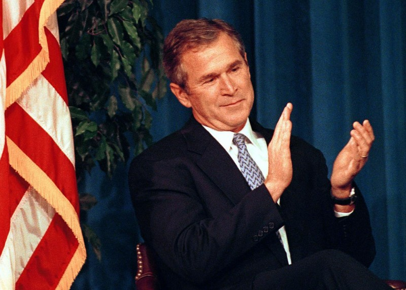 Republican US presidential candidate, Texas Governor George W. Bush applauds remarks by former US Secretary of State George Shultz prior to delivering a foreign policy speech at the Ronald Reagan Library 19 November 1999 in Simi Valley, California. Bush, the frontrunner for the Republican Party's presidential nomination, outlined his vision for the US role in the world.  AFP PHOTO/Jim RUYMEN
