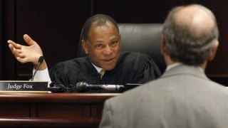 Judge Carl Fox speaks with John Edwards' lawyer, Jim Cooney, in Raleigh, North Carolina, on Thursday, June 16, 2011. Fox ruled that Edwards would not have to take part in a question-and-answer session under oath next week related to the legal wrangle over a videotape that purportedly shows him having sex with his mistress. (Shawn Rocco/Raleigh News & Observer/MCT via Getty Images)