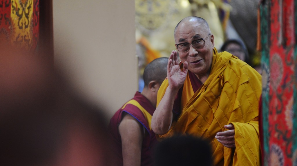 Tibetan spiritual leader His Holiness the Dalai Lama greets followers before starting lectures on Buddhist philosophy at the Tsuglakhang Temple in McLeod Ganj on September 10, 2015. AFP PHOTO / Lobsang Wangal