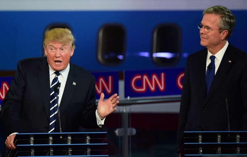 Republican presidential hopefuls  Donald Trump (L) and Jeb Bush participate in the Republican presidential debate at the Ronald Reagan Presidential Library in Simi Valley, California on September 16, 2015.  Republican presidential frontrunner Donald Trump stepped into a campaign hornet's nest as his rivals collectively turned their sights on the billionaire in the party's second debate of the 2016 presidential race.  AFP PHOTO / FREDERIC J. BROWN