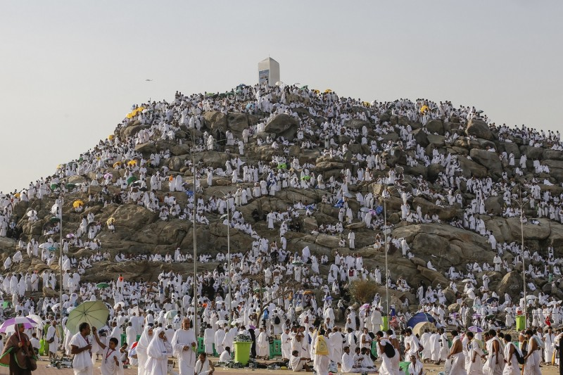 MECCA, SAUDI ARABIA - SEPTEMBER 23:  Muslim pilgrims are seen on the Mount Arafat, also known as Jabal al-Rahmah (Mount of Mercy), where the Prophet Mohammed is believed to have given his final sermon, in Mecca, Saudi Arabia on September 23, 2015, ahead of the climax of hajj. Muslim pilgrims, dressed in white, headed to Mount Arafat, in western Saudi Arabia, to take part in the main rituals of the annual hajj and to become pilgrims on the eve of Eid al-Adha (Feast of Sacrifice). (Photo by Ozkan Bilgin/Anadolu Agency/Getty Images)