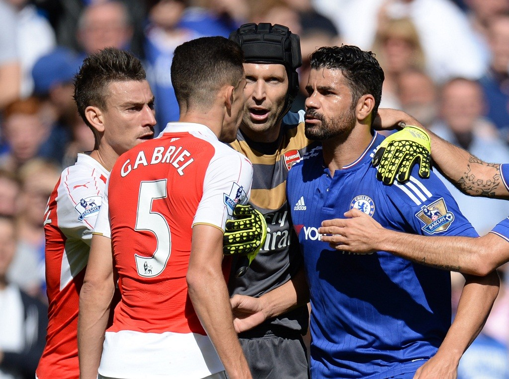 Diego Costa of Chelsea grapples with Gabriel Paulista of Arsenal and Laurent Koscielny of Arsenal eventually leading to a sending off for Gabriel Paulista during the English championship Premier League football match between Chelsea and Arsenal on september 19, 2015 at Stamford Bridge in London, England. Photo Javier Garcia / Backpage Images / DPPI