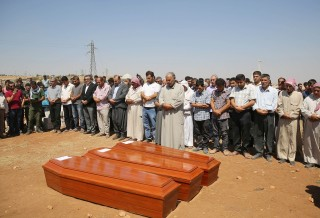 KOBANI, SYRIA - SEPTEMBER 4: Relatives hold funeral of Syrian children Aylan, 2, his brother Galip, 3, and husband of Zahin Kurdi, 27, who drowned after their boat sank en route to the Greek islands in the Aegean Sea, in the Syrian border town of Kobani (Ayn al-Arab) on September 4, 2015. The 12 people, including eight children, drowned after their boat sank en route to the Greek islands in the Aegean Sea. (Photo by Isa Terli/Anadolu Agency/Getty Images)
