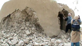 """FILES - A still taken from a video shows Islamist militants destroying an ancient shrine in Timbuktu on July 1, 2012. An alleged Al-Qaeda linked Islamist leader was on September 26, 2015 handed over to the International Criminal Court to face charges of aiding the destruction of Mali's fabled city of Timbuktu, in the first such case before the tribunal. He is suspected """"of war crimes allegedly committed in Timbuktu, Mali, between about 30 June 2012 and 10 July 2012, through intentionally directing attacks against buildings dedicated to religion and/or historical monuments,"""" the statement said. AFP PHOTO"""