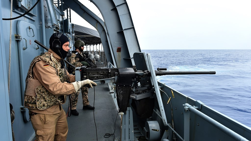 Sailors of the German navy frigate ship Werra make a fire-self-defence practice in the Mediterranean Sea not far from the Libyan territorial waters on September 25, 2015. The German ship is part of the EU operation EuNavFor Med of rescuing migrants crossing the Mediterranean Sea from North Africa to Europe. AFP PHOTO / ALBERTO PIZZOLI