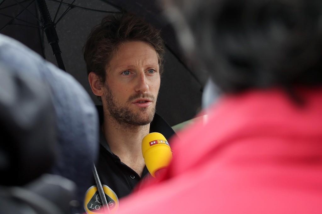 Lotus driver Romain Grosjean of France speaks to reporters ahead of the Formula One Japanese Grand Prix in Suzuka on September 24, 2015.  AFP PHOTO/YURIKO NAKAO
