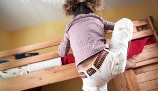 Girl Climbing into Her Bunk Bed