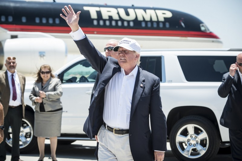 LAREDO, TEXAS - JULY 23:  Republican Presidential candidate and business mogul Donald Trump exits his plane during his trip to the border on July 23, 2015 in Laredo, Texas. Trump's recent comments, calling some immigrants from Mexico as drug traffickers and rapists, have stirred up reactions on both sides of the aisle. Although fellow Republican presidential candidate Rick Perry has denounced Trump's comments and his campaign in general, U.S. Senator from Texas Ted-Cruz has so far refused to bash his fellow Republican nominee. (Photo by Matthew Busch/Getty Images)