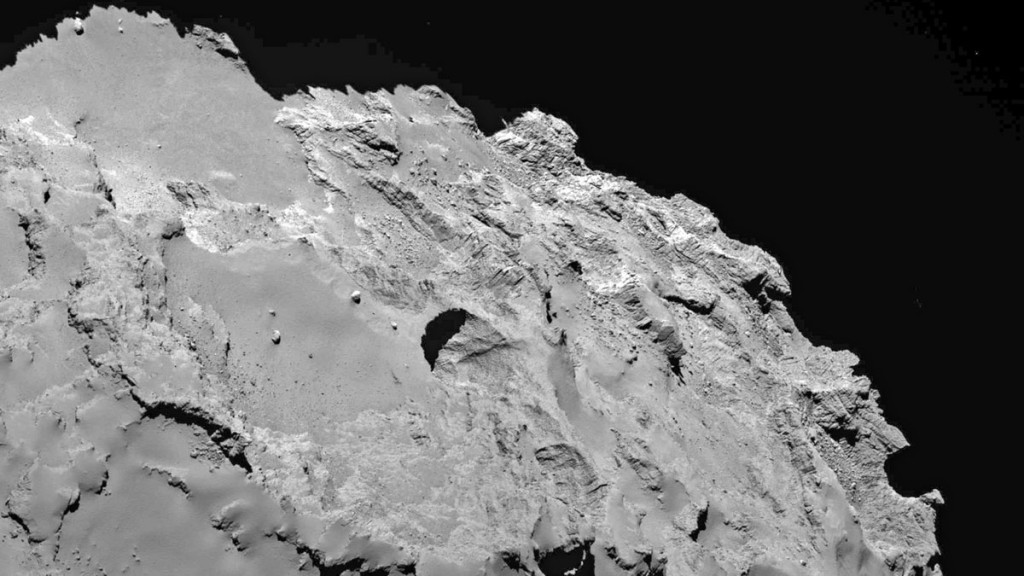 """A handout photo provided by Nature on July 1, 2015 shows a close-up image of the most active pit, known as Seth 01, observed on the surface of the comet 67P/Churyumov-Gerasimenko by the Rosetta spacecraft. The European Space Agency's Rosetta spacecraft first began orbiting comet 67P/Churyumov-Gerasimenko in August 2014. Almost immediately, scientists began to wonder about several surprisingly deep, almost perfectly circular pits on the comet's surface. Now, a new study based on close-up imagery taken by Rosetta suggests that these pits are sinkholes, formed when ices beneath the comet's surface sublimate, or turn directly to gas.  AFP PHOTO / NATURE / THE UNIVERSITY OF MARYLAND, COLLEGE PARK / JEAN-BAPTISTE VINCENT= RESTRICTED TO EDITORIAL USE - MANDATORY CREDIT """"AFP PHOTO / NATURE / THE UNIVERSITY OF MARYLAND, COLLEGE PARK / JEAN-BAPTISTE VINCENT"""" - NO MARKETING NO ADVERTISING CAMPAIGNS - DISTRIBUTED AS A SERVICE TO CLIENTS ="""