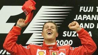 German Ferrari driver Michael Schumacher celebrates on the podium, 08 October 2000, of the Suzuka racetrack after winning the Japan Formula One Grand Prix. Schumacher sealed the driver's championship ahead of arch-rival McLaren-Mercedes driver Mika Hakkinen of Finland.  AFP PHOTO/Patrick HERTZOG