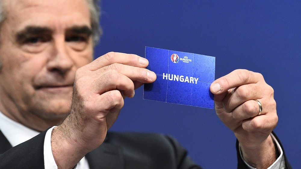 head of the National Commission of Ethics of the French Football Association  Dominique Rocheteau shows the name of Hungary during the UEFA Euro 2016 football championships play-off draw ceremony on October 18, 2015 in Nyon, Switzerland. The Euro 2016 will run in France from June 10 to July 10, 2016.  AFP PHOTO / ALAIN GROSCLAUDE