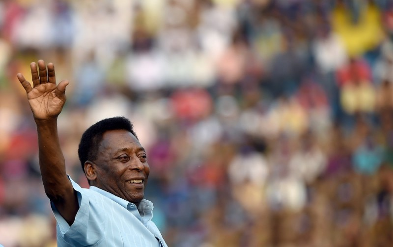 Former Brazilian footballer Pele greets the crowd before the start of the Under-17 boys final match of the Subroto Cup in New Delhi on October 16, 2015. Pele is on a two day visit to the city at the invitation of the Subroto Cup International.   AFP PHOTO/ MONEY SHARMA