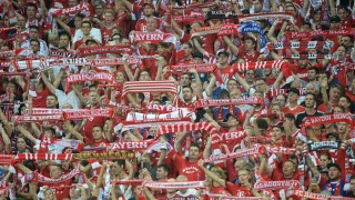 Fans of Bayern Munich cheer during the German first division Bundesliga football match FC Bayern Munich vs Hamburger SV at the Allianz Arena in Munich, southern Germany, on August 14, 2015. The match is the first of the 2015/2016 season. AFP PHOTO / DPA SVEN HOPPE +++ GERMANY OUT +++  RESTRICTIONS: DURING MATCH TIME: DFL RULES TO LIMIT THE ONLINE USAGE TO 15 PICTURES PER MATCH AND FORBID IMAGE SEQUENCES TO SIMULATE VIDEO.  == RESTRICTED TO EDITORIAL USE == FOR FURTHER QUERIES PLEASE CONTACT DFL DIRECTLY AT + 49 69 650050.