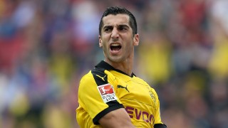 Dortmund's Armenian midfielder Henrik Mkhitaryan reacts during the German first division Bundesliga football match Hannover 96 v Borussia Dortmund, in Hannover, on September 12, 2015.  AFP PHOTO /  RONNY HARTMANN  RESTRICTIONS: DURING MATCH TIME: DFL RULES TO LIMIT THE ONLINE USAGE TO 15 PICTURES PER MATCH AND FORBID IMAGE SEQUENCES TO SIMULATE VIDEO.  == RESTRICTED TO EDITORIAL USE == FOR FURTHER QUERIES PLEASE CONTACT DFL DIRECTLY AT + 49 69 650050.