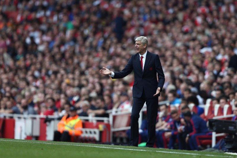 """Arsenal's French manager Arsene Wenger gestures from the sideline during the English Premier League football match between Arsenal and Manchester United at the Emirates Stadium in London on October 4, 2015.    AFP PHOTO / JUSTIN TALLIS  RESTRICTED TO EDITORIAL USE. No use with unauthorised audio, video, data, fixture lists, club/league logos or """"live"""" services. Online in-match use limited to 45 images, no video emulation. No use in betting, games or single club/league/player publications."""