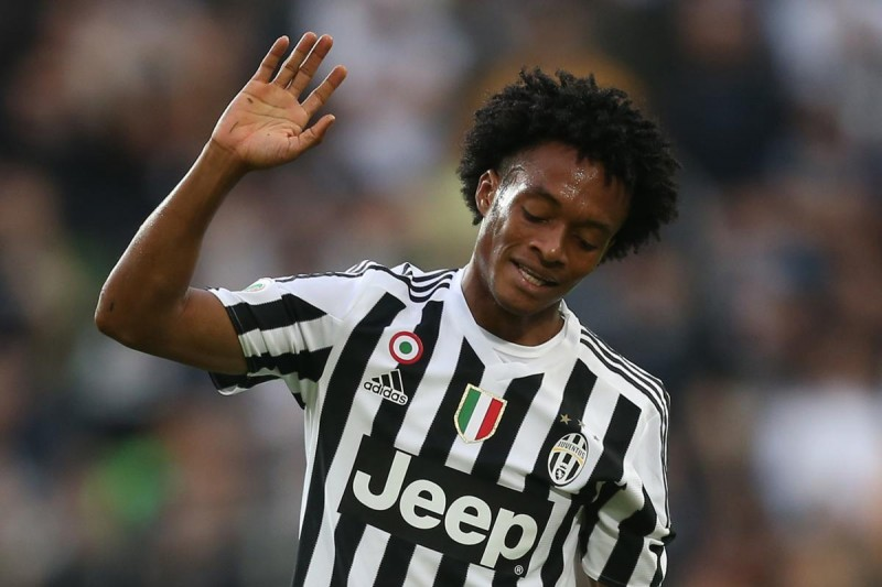 """Juventus' midfielder Juan Cuadrado from Colombia reacts during the Italian Serie A  football match Juventus Vs Bologna on October 4, 2015 at the """"Juventus Stadium"""" in Turin.  AFP PHOTO / MARCO BERTORELLO"""