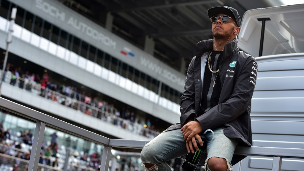 Mercedes AMG Petronas F1 Team's British driver Lewis Hamilton takes part in the drivers' parade ahead of the Russian Formula One Grand Prix at the Sochi Autodrom circuit in Sochi on October 11, 2015.  AFP PHOTO / ANDREJ ISAKOVIC