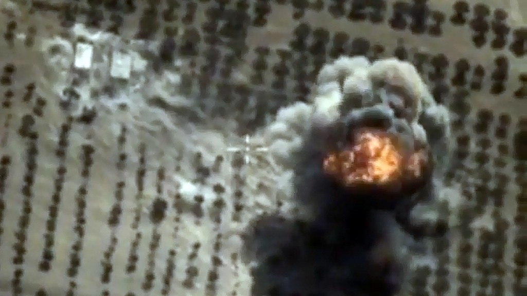 """A video grab made on October 15, 2015, shows an image taken from a footage made available on the Russian Defence Ministry's official website, purporting to show an explosion after airstrikes carried out by Russian air force on what Russia says was an Islamic State facility in the Syrian province of Idlib. AFP PHOTO / RUSSIAN DEFENCE MINISTRY  *RESTRICTED TO EDITORIAL USE - MANDATORY CREDIT """" AFP PHOTO / RUSSIAN DEFENCE MINISTRY"""" - NO MARKETING NO ADVERTISING CAMPAIGNS - DISTRIBUTED AS A SERVICE TO CLIENTS*"""