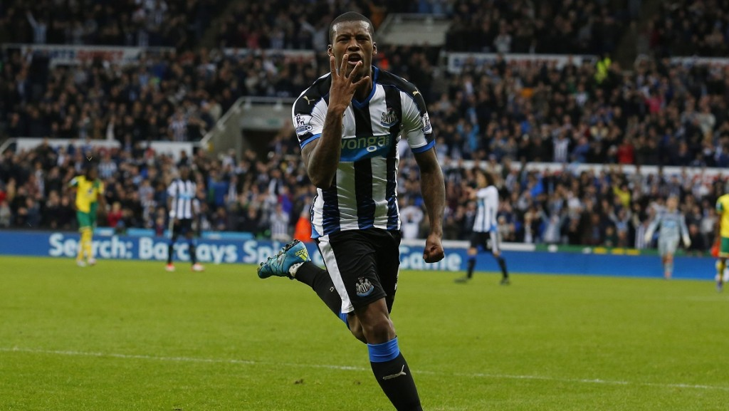 Newcastle United's Dutch midfielder Georginio Wijnaldum celebrates after scoring his fourth goal, Newcastle's sixth, during the English Premier League football match between Newcastle United and Norwich City at St James' Park in Newcastle-upon-Tyne, north east England, on October 18, 2015. Newcastle won the game 6-2. AFP PHOTO / LINDSEY PARNABY  RESTRICTED TO EDITORIAL USE. No use with unauthorized audio, video, data, fixture lists, club/league logos or 'live' services. Online in-match use limited to 75 images, no video emulation. No use in betting, games or single club/league/player publications.
