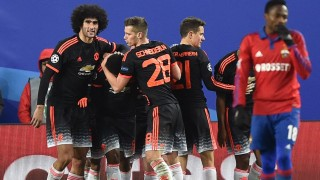 Manchester United's players celebrate after Manchester United's French forward Anthony Martial scored a goal during the UEFA Champions League group B football match between PFC CSKA Moscow and FC Manchester United at the Arena Khimki stadium outside Moscow on October 21, 2015. AFP PHOTO / KIRILL KUDRYAVTSEV