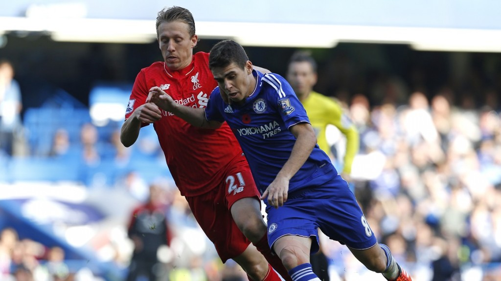 Liverpool's Brazilian midfielder Lucas Leiva (L) vies with Chelsea's Brazilian midfielder Oscar during the English Premier League football match between Chelsea and Liverpool at Stamford Bridge in London on October 31, 2015. AFP PHOTO / IAN KINGTON  RESTRICTED TO EDITORIAL USE. No use with unauthorized audio, video, data, fixture lists, club/league logos or 'live' services. Online in-match use limited to 75 images, no video emulation. No use in betting, games or single club/league/player publications.