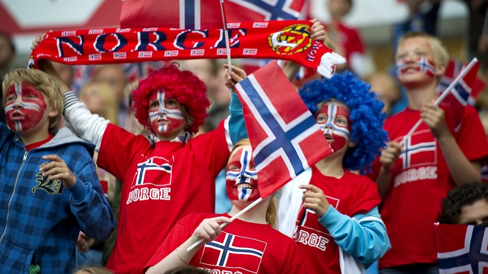 Norwegian soccer fans cheer their team during the EURO 2012 friendly football match Norway vs Lithuania at the Ullevaal Stadium in Oslo, on June 7, 2011. AFP PHOTO / ODD ANDERSEN