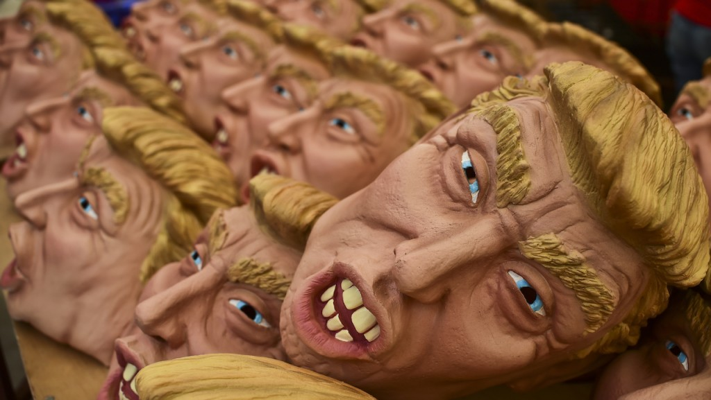 Masks representing US Republican presidential candidate Donald Trump are pictured in a factory of costumes and masks, on October 16, 2015, in Jiutepec, Morelos State. AFP PHOTO/RONALDO SCHEMIDT