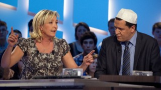 """French far-right Front National (FN) party's candidate for the 2012 presidential election, Marine Le Pen and Hassen Chalghoumi (R), imam of the Drancy mosque in Seine-Saint-Denis, take part in a TV broadcast show """"Le Grand Journal"""" on Canal Plus channel, on March 9, 2012 in Paris. AFP PHOTO / JOEL SAGET"""