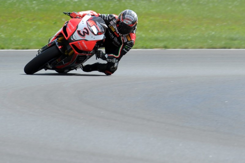 Italian rider Max Biaggi of Aprilia Racing Team, who won the third place, rides during the first race of the Superbike World Championship on the Moscow Raceway circuit, close to the city Volokolamsk, around 100 km west from Moscow on August 26, 2012 . AFP PHOTO/KIRILL KUDRYAVTSEV